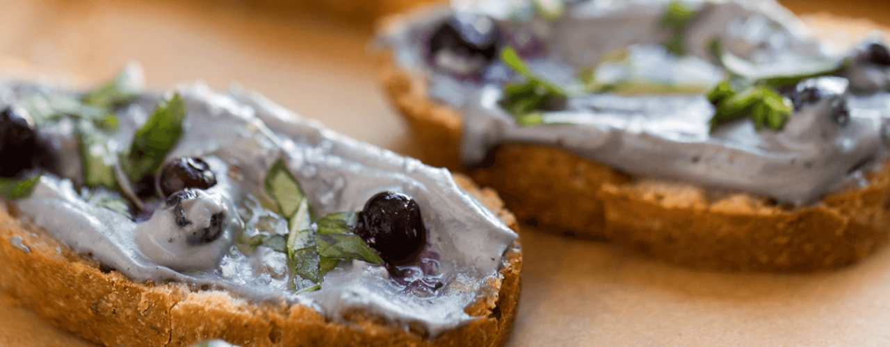 Vegan Wild Blueberry Cashew Spread on Crostini with Fresh Basil